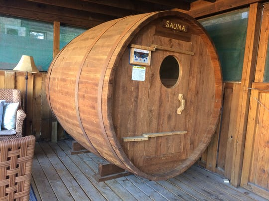 A whiskey barrel sauna offers a unique experience, especially after a day on the ski slopes.
