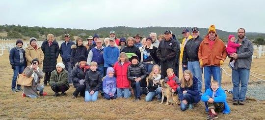 Volunteers honored the veterans buried at Fort Stanton military cemetery.