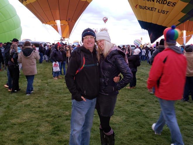 Rich and Anna Dozier take a moment to enjoy the Albuquerque International Balloon Fiesta.