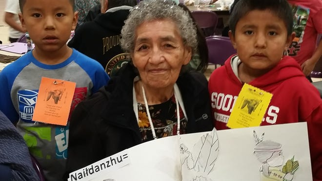 Mescalero Apache schools celebrated Elders day on Friday Nov. 16.  Patrick Users and Carmelo Users are great-grandsons of Clarice Rocha.  They presented a poster to her they made in Apache language class. The elders enjoyed arts and crafts, played Bingo and had a lunch in the school cafeteria.