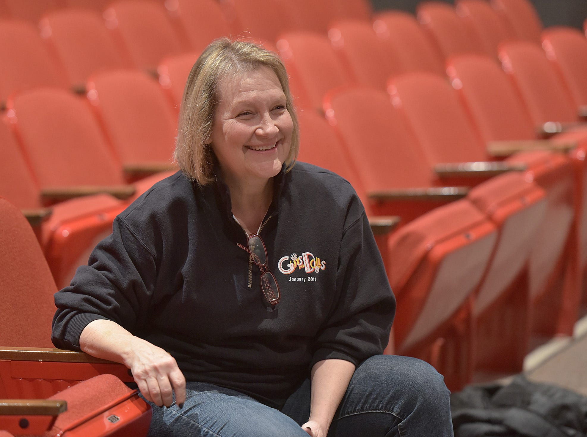 Sue Cobb watches Dean Cobb direct the students in The Election. The Cobbs retired from teaching back in 2011 but still come back whenever there's a show. They are wondering what to do when Harrison closes in June.