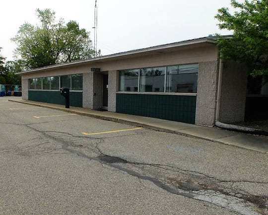This photo of the city of Plymouth municipal offices shows the problematic area before a rain garden was installed.