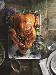 Kitchen Toke publishes pot-infused recipes. Pictured, an herb-roasted turkey with pancetta, porcini and shallot-cannabis stuffing.