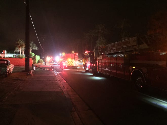 Emergency vehicles line Portola Avenue while responding to a power pole and structure fire Monday in Palm Desert.