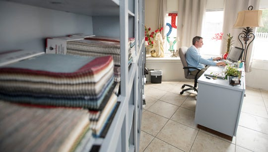 Co-owner Christopher Strawderman works in his office at the new Barrancas Interiors on Barrancas Avenue in Pensacola on Tuesday, November 20, 2018.