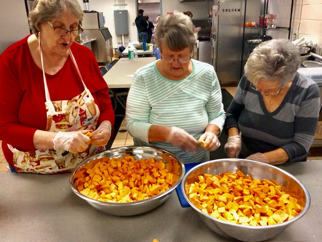 Jan Wilson, Mona Ward, and Betty Salter, with the Santa Rosa County Home and Community Educators, are cutting up some sweet potatoes for the Thanksgiving meal for the Thanksgiving Senior Dinner that was held Thursday Nov. 22 at the Guy Thompson Community Center.