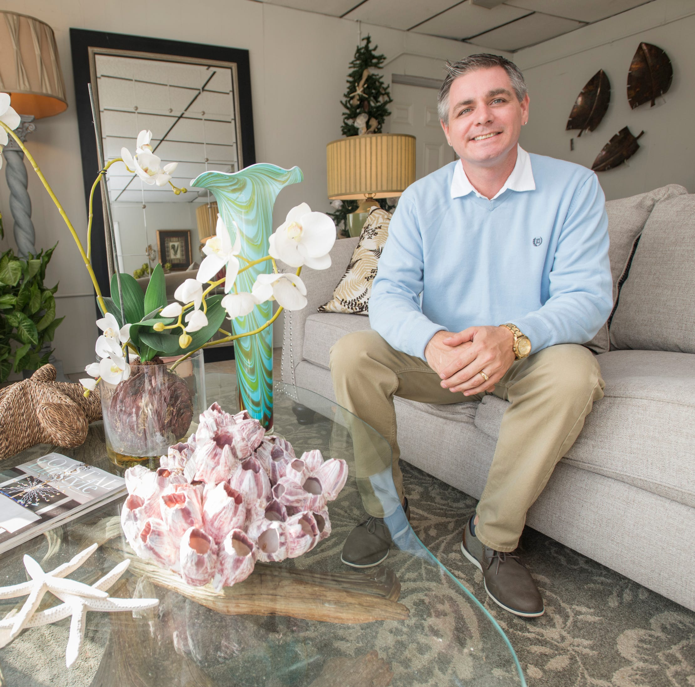 Co-owner Christopher Strawderman poses in the showroom of the new Barrancas Interiors on Barrancas Avenue in Pensacola on Tuesday, November 20, 2018.