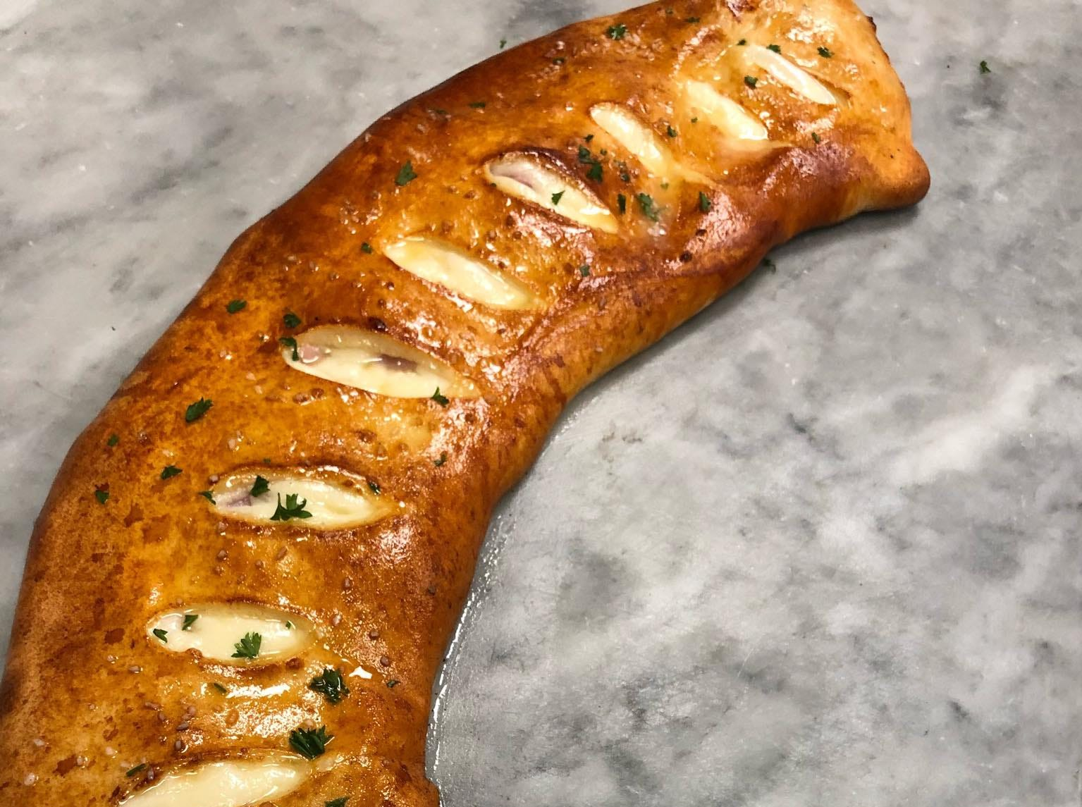 Located at 1 Center Square,  Divino Pizzeria & Grille makes Italian favorites as well as wings, subs and salads. Pictured here is their pretzel boli.
