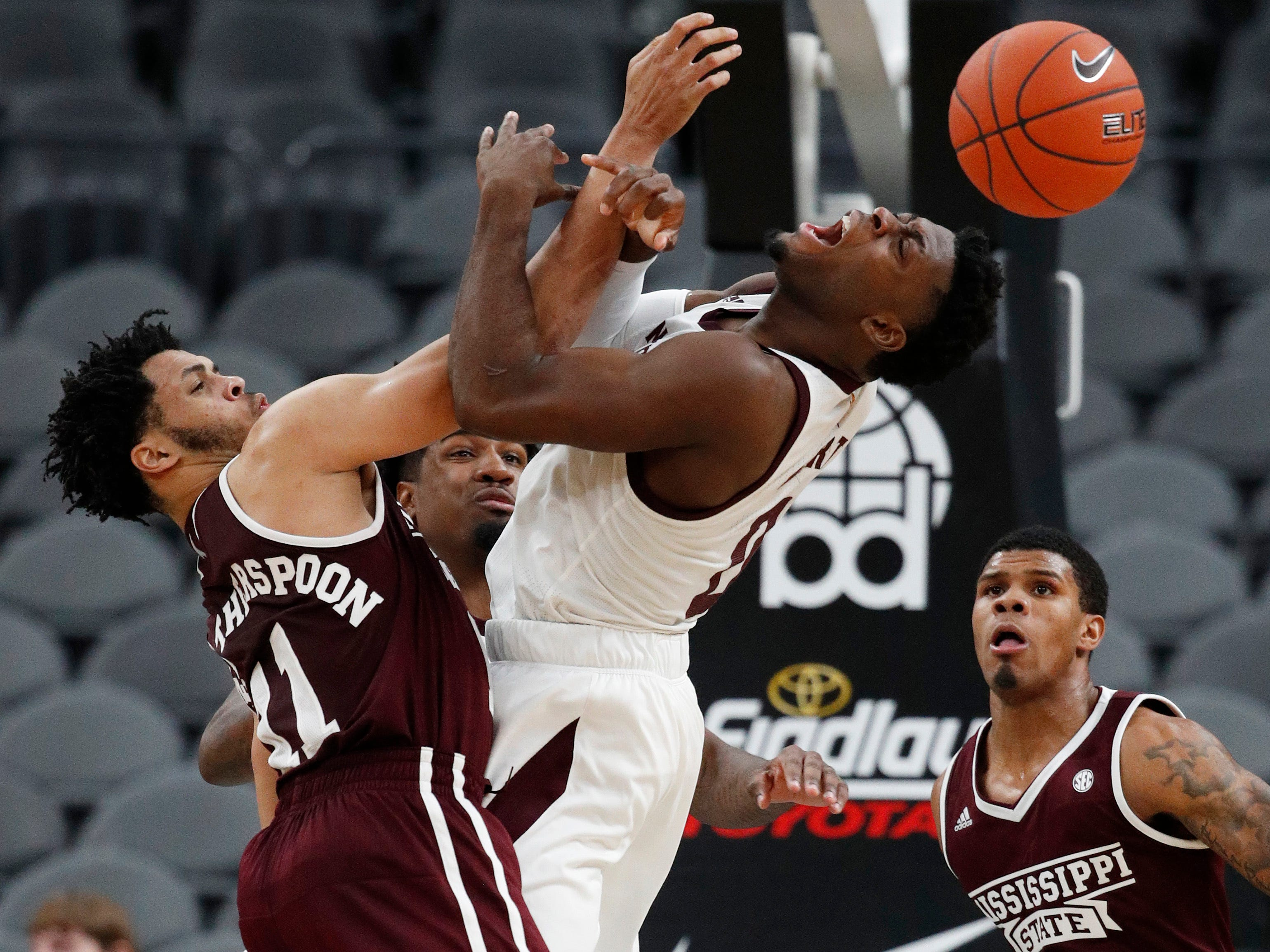 Mississippi State's Quinndary Weatherspoon (11) and Arizona State's Luguentz Dort (0) vie for the ball during the second half of an NCAA college basketball game, Monday, Nov. 19, 2018, in Las Vegas. Arizona State won 72-67.
