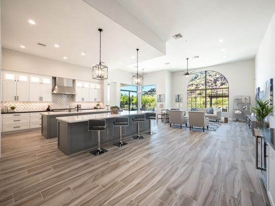 The kitchen has double islands and features Campina and obsidian quartz countertops.