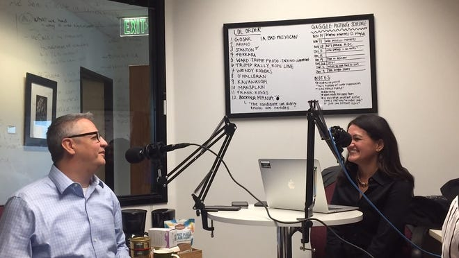 Arizona Republic reporters Ron Hansen and Yvonne Wingett Sanchez laugh while recording an episode of The Gaggle.