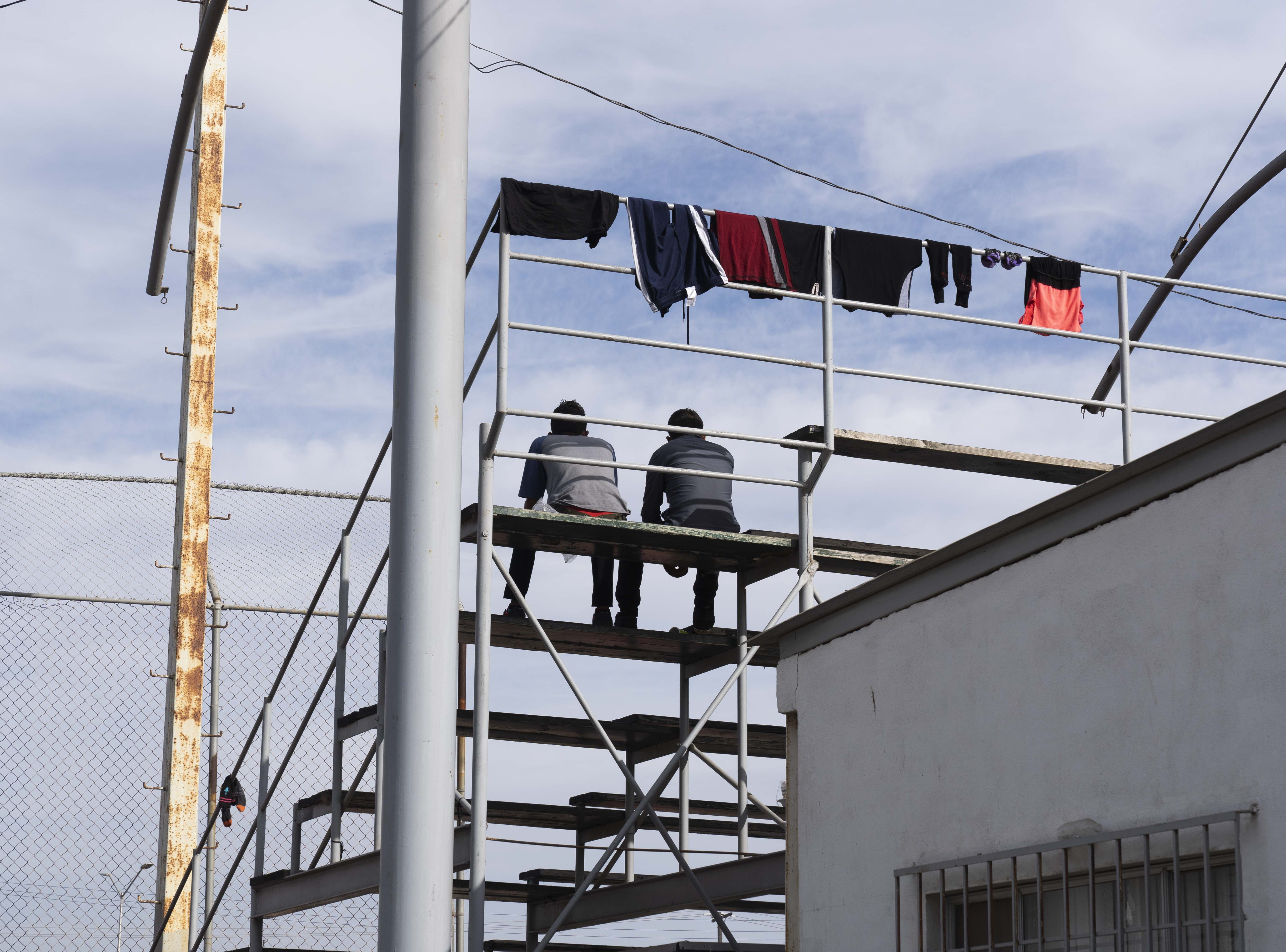 Over 2,500 mostly Central American migrants were staying at the Unidad Deportiva Benito Juarez, a makeshift shelter, in Tijuana, Mexico, on Nov. 18, 2018. Migrants set up camp around the baseball stadium, propping up tents using whatever materials they have available.