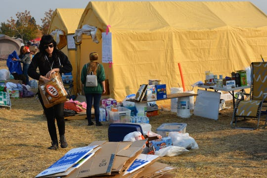 Molly Roberts volunteers at an encampment outside of a Walmart in Chico, CA., Nov. 19, 2018. The gathering was smaller than in days prior, but dozens of people remained.