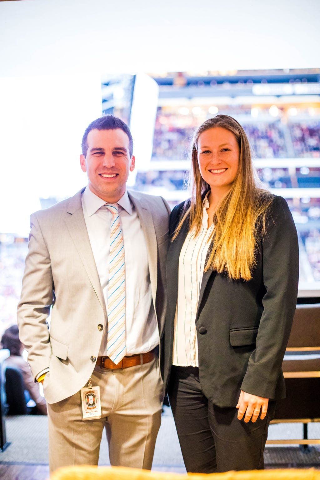 Lyndsey Fry (right) poses with Coyotes President and CEO Ahron Cohen at a recent game at Gila River Arena.