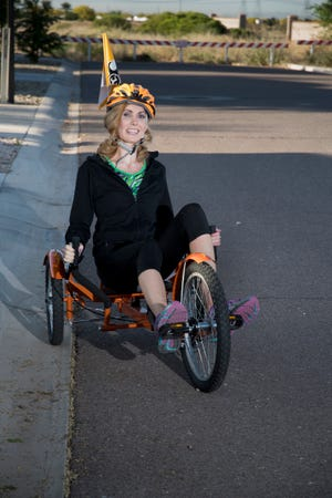 Laura Triem loves getting a workout on her recumbent bike as a part of her continued rehab from a horriffic accident in which she was hit by a light rail train while crossing the street in Denver.
