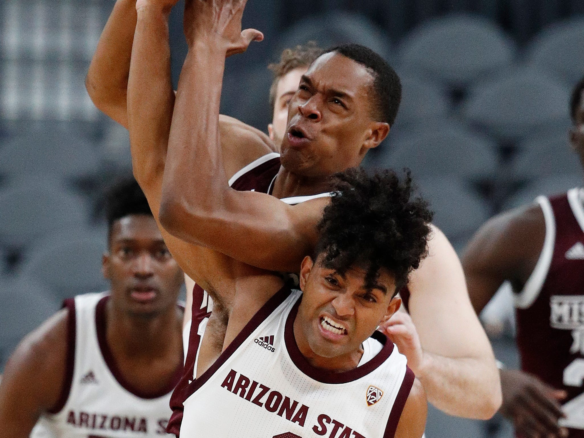 Arizona State's Remy Martin (1) fouls Mississippi State's Robert Woodard II during the first half of a NCAA college basketball game Monday, Nov. 19, 2018, in Las Vegas. (AP Photo/John Locher)