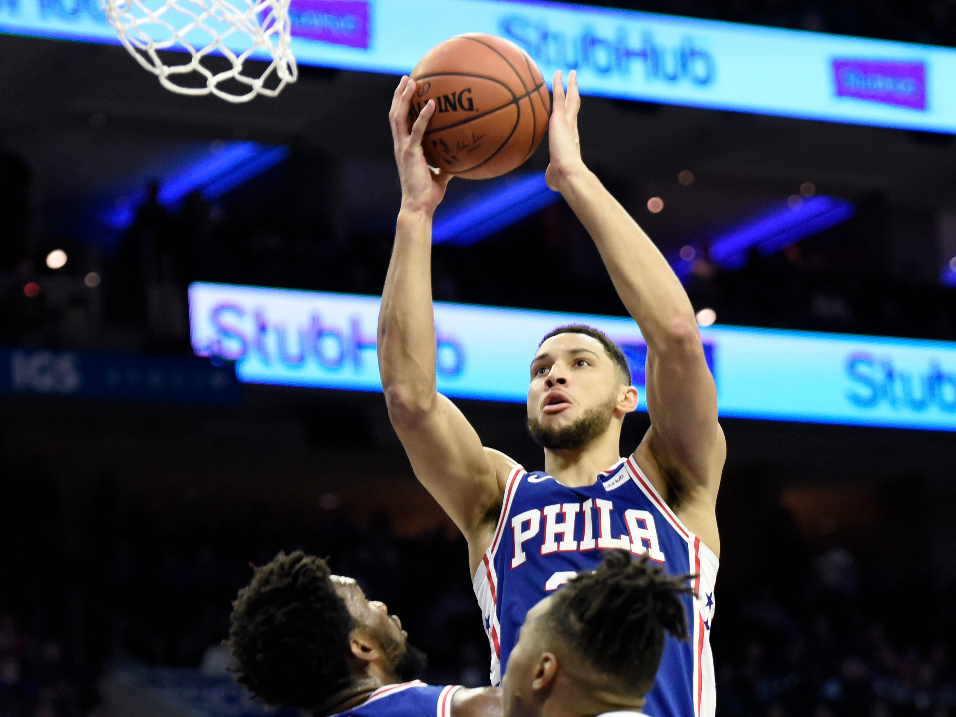 Philadelphia 76ers' Ben Simmons (25) takes a jump shot as Phoenix Suns' Richaun Holmes (21) defends in the second half of an NBA basketball game, Monday, Nov. 19, 2018, in Philadelphia. The 76ers beat the Suns 119-114. (AP Photo/Michael Perez)