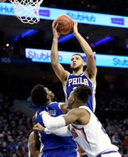 Philadelphia point guard Ben Simmons shoots over Suns center Richaun Holmes during a game Monday.