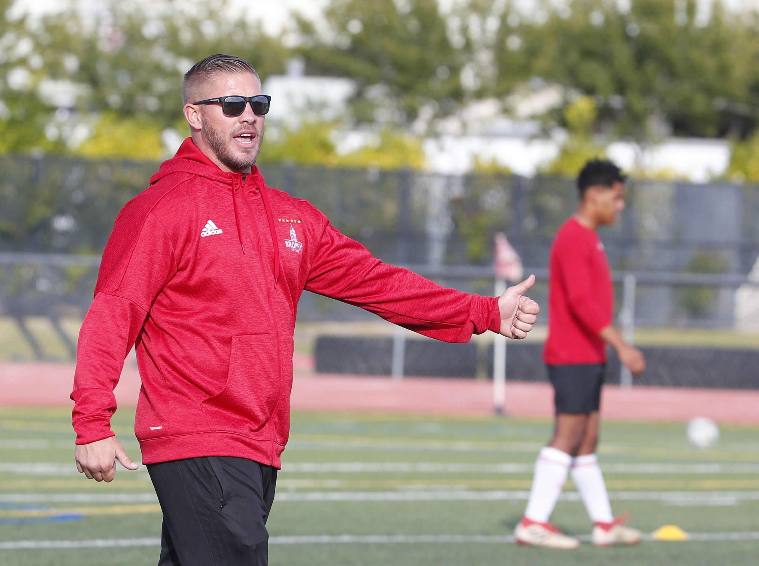 Brophy Prep head soccer coach Paul Allen instructs his team during practice in Phoenix on Nov. 14, 2018.
