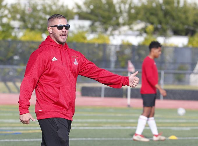 Brophy Prep head soccer coach Paul Allen instructs his team during practice in Phoenix on Nov. 14, 2018.