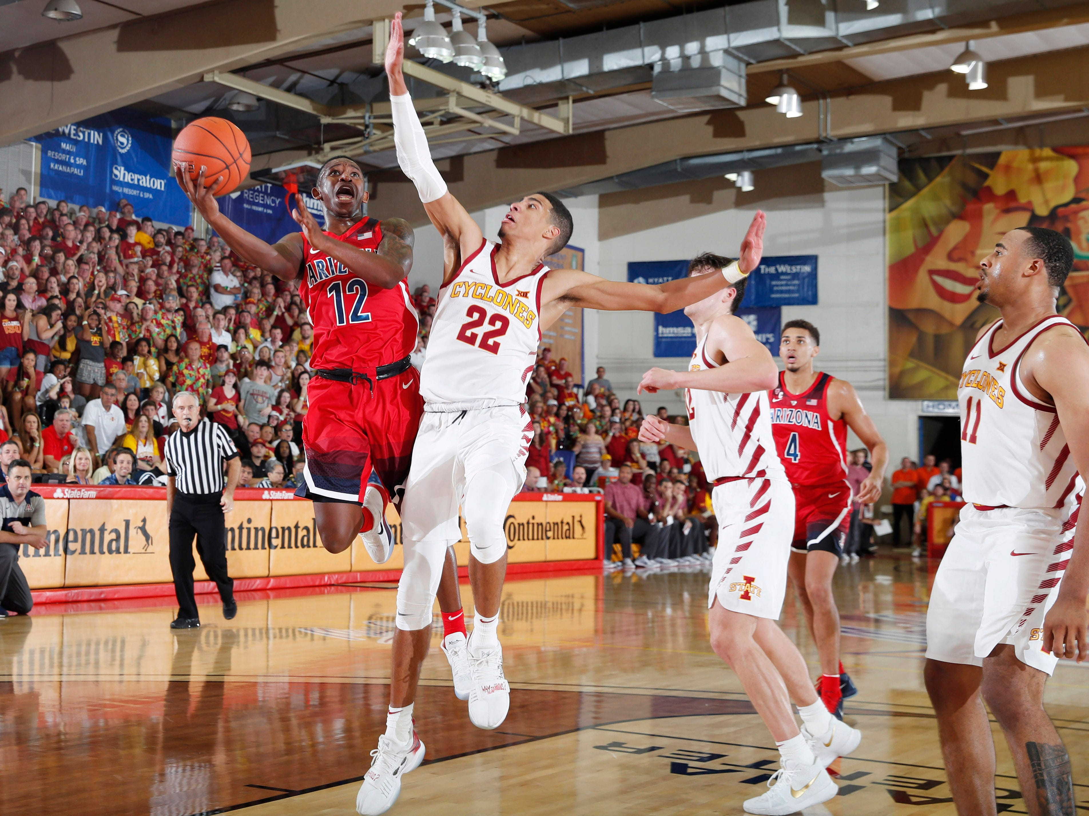 Nov 19, 2018: Arizona Wildcats guard Justin Coleman (12) takes a shot against Iowa State Cyclones guard Tyrese Haliburton (22) in the second half during round one of the Maui Jim Maui Invitational at Lahaina Civic Center.