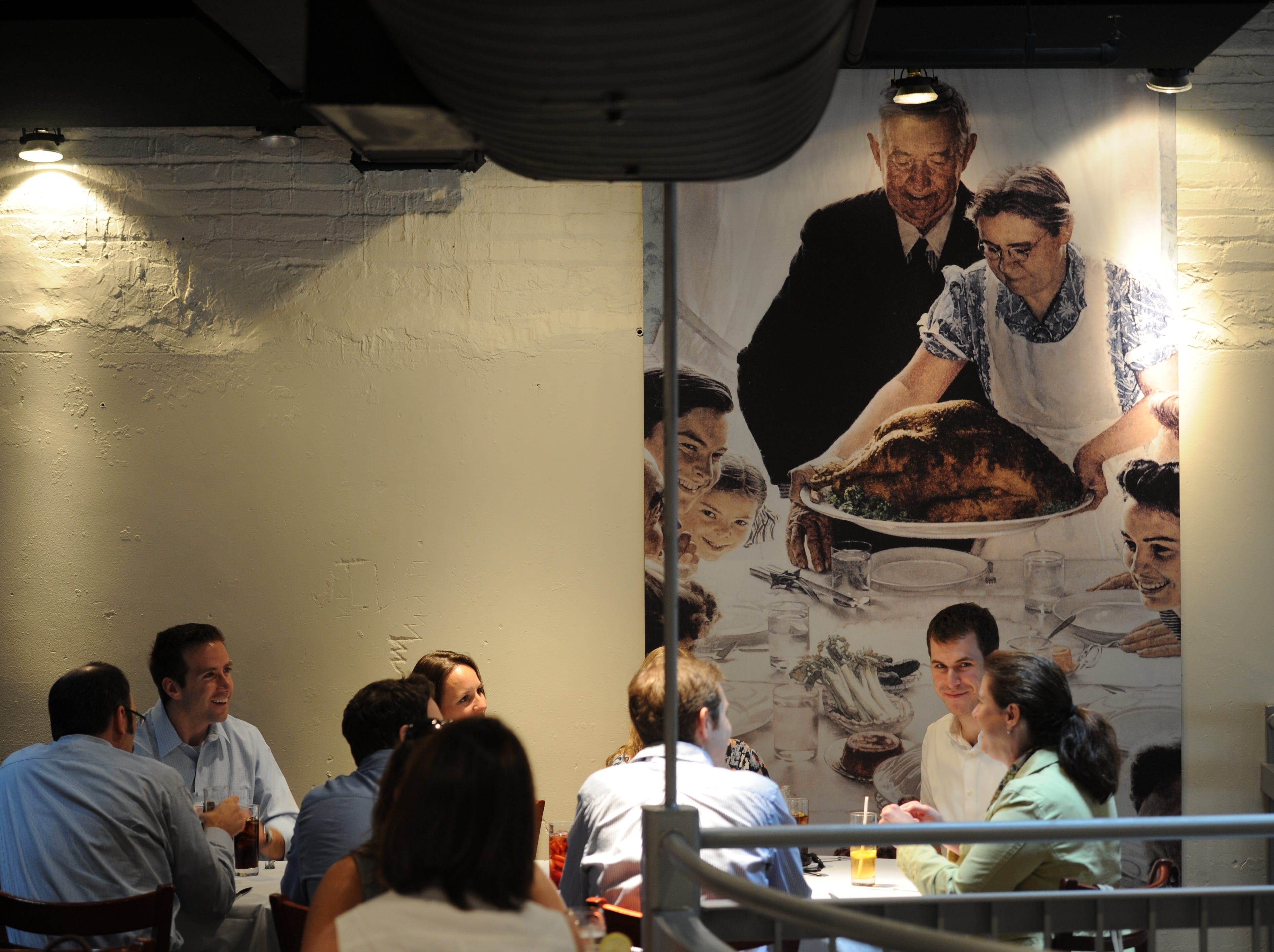 "7/21/11 12:51:17 PM -- Washington, DC, U.S.A -- America Eats Tavern in Washington, D.C. features a print of the Norman Rockwell painting ""Freedom from Want.""