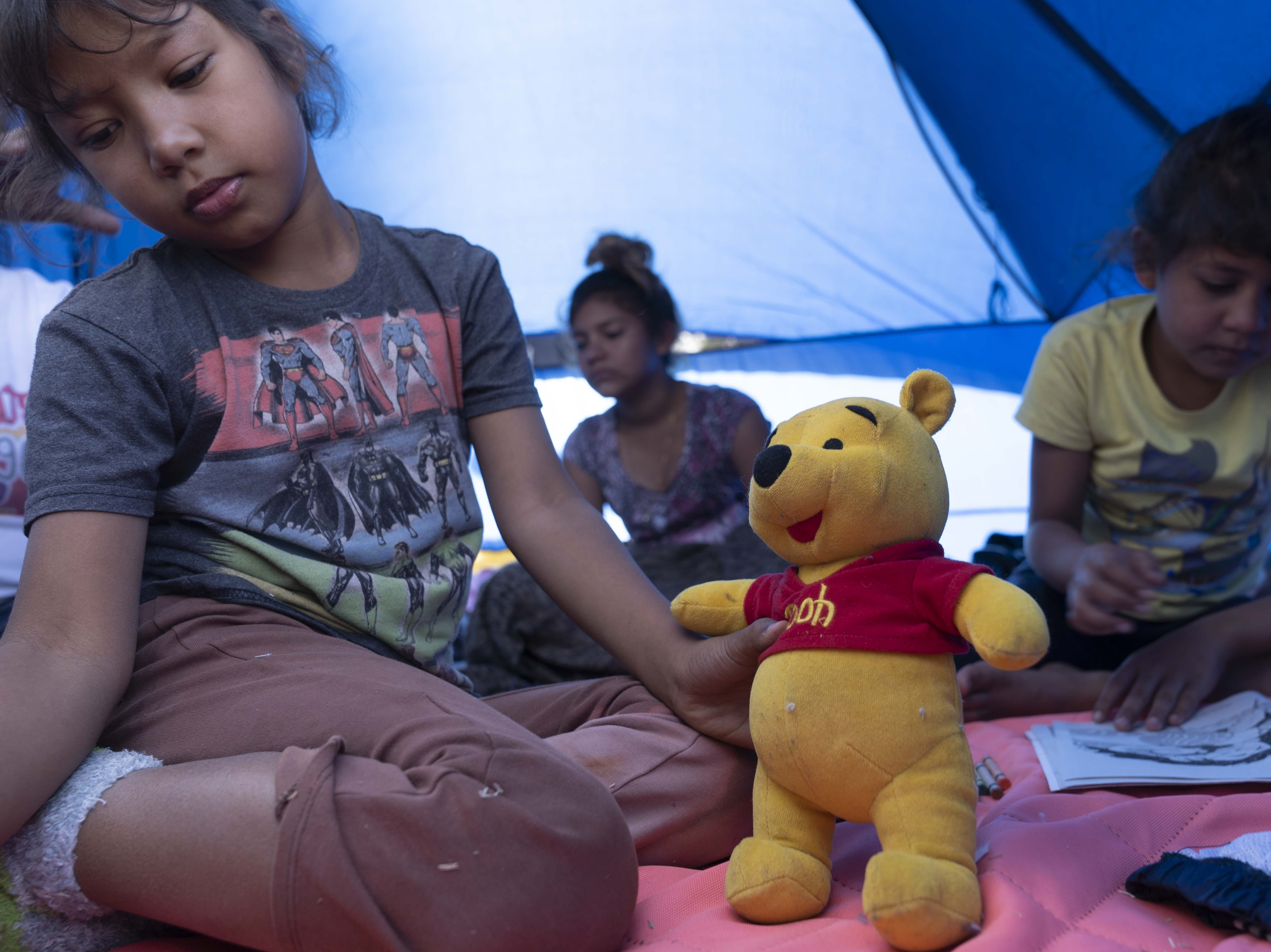 More than 2,500 mostly Central American migrants were staying at the Unidad Deportiva Benito Juarez, a makeshift shelter, in Tijuana, Mexico, on Nov. 18, 2018. Migrants set up camp around the baseball stadium, propping up tents using whatever materials they have available.