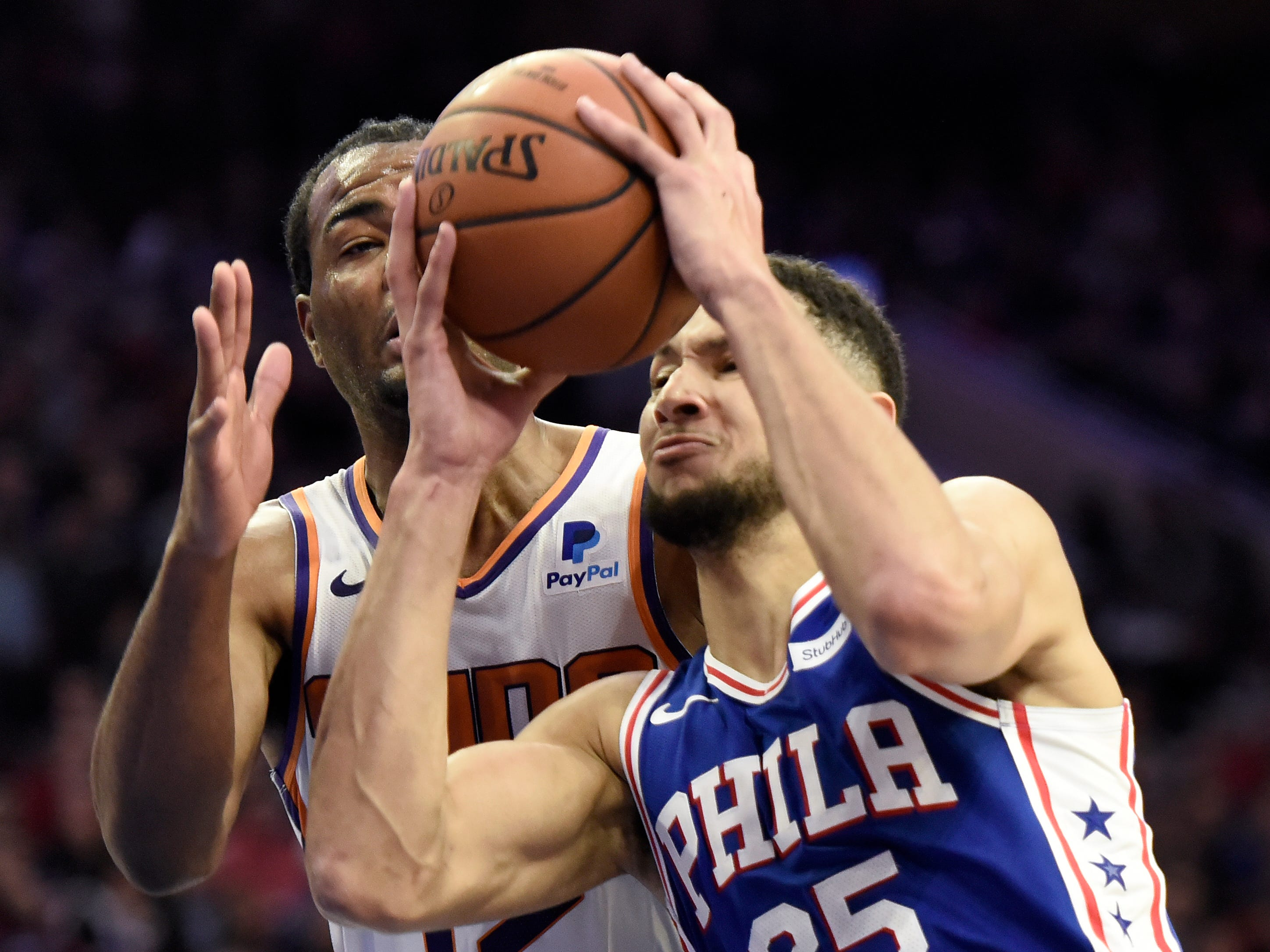 Philadelphia 76ers' Ben Simmons (25) drives the ball to the basket as Phoenix Suns' TJ Warren defends in the second half of an NBA basketball game, Monday, Nov. 19, 2018, in Philadelphia. The 76ers beat the Suns 119-114.