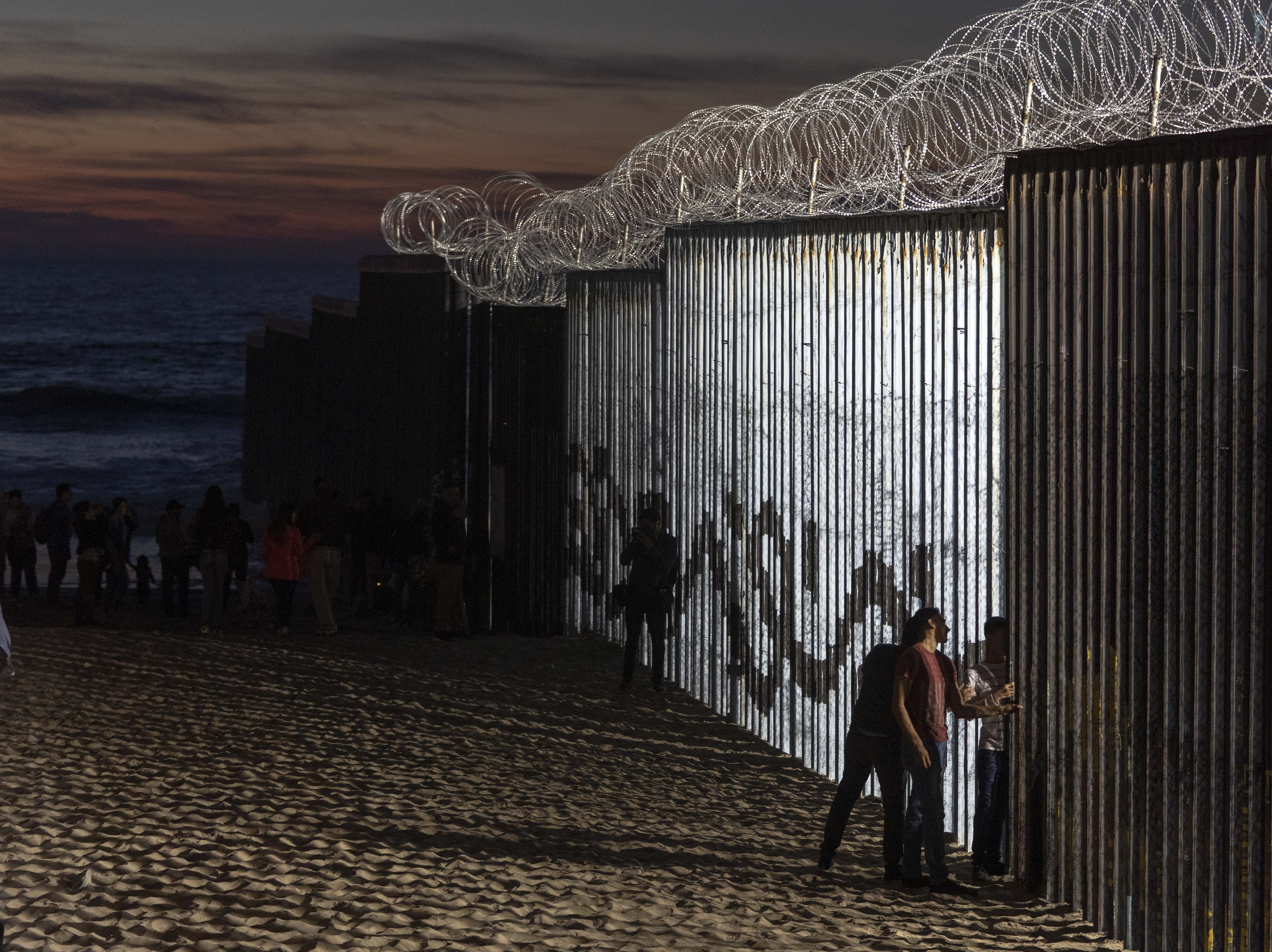 The barbed wire perched atop the U.S.-Mexico border fence, seen here Nov. 18, 2018, has become a viewing attraction for visitors to the popular Playas de Tijuana neighborhood south of San Diego.