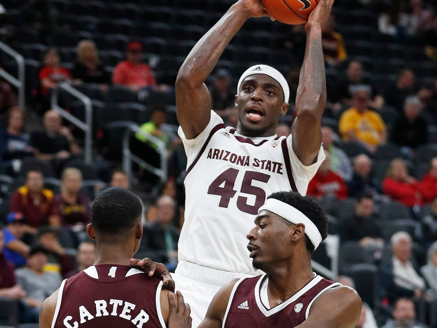 Arizona State's Zylan Cheatham (45) shoots over Mississippi State's Tyson Carter (23) and Aric Holman (35) during the first half of a NCAA college basketball game Monday, Nov. 19, 2018, in Las Vegas. (AP Photo/John Locher)