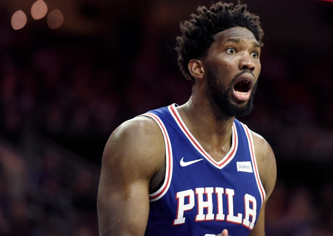 Philadelphia 76ers' Joel Embiid (21) reacts to a referee call in the second half of an NBA basketball game against the Phoenix Suns, Monday, Nov. 19, 2018, in Philadelphia. The 76ers beat the Suns 119-114.
