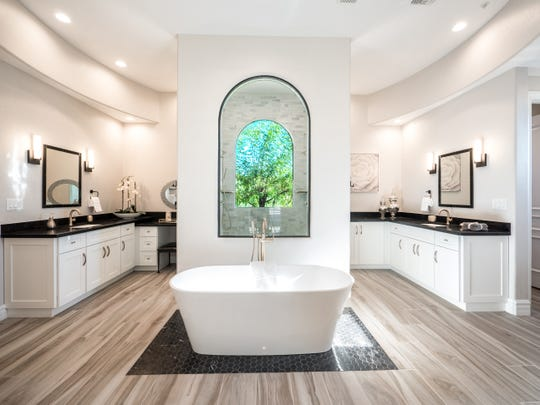 The master bedroom suite includes a bathroom with an elegant Victoria and Albert limestone tub.
