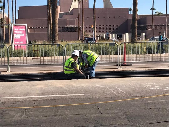 Construction crews begin laying streetcar track on Mill Avenue south of University Drive.
