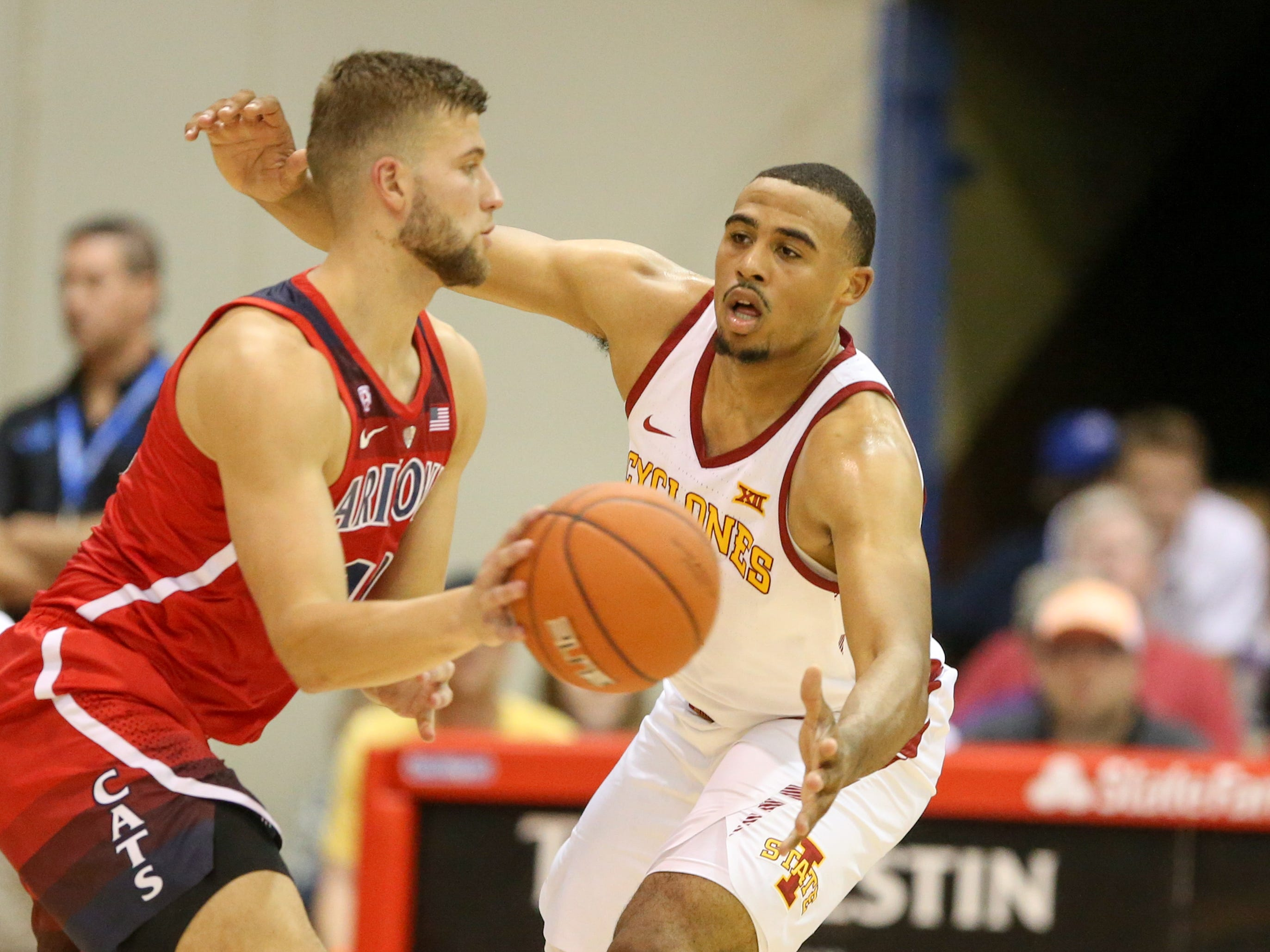 Talen Horton-Tucker #11 of the Iowa State Cyclones guards Ryan Luther #10 of the Arizona Wildcats during the first half of the game at Lahaina Civic Center on November 19, 2018 in Lahaina, Hawaii.