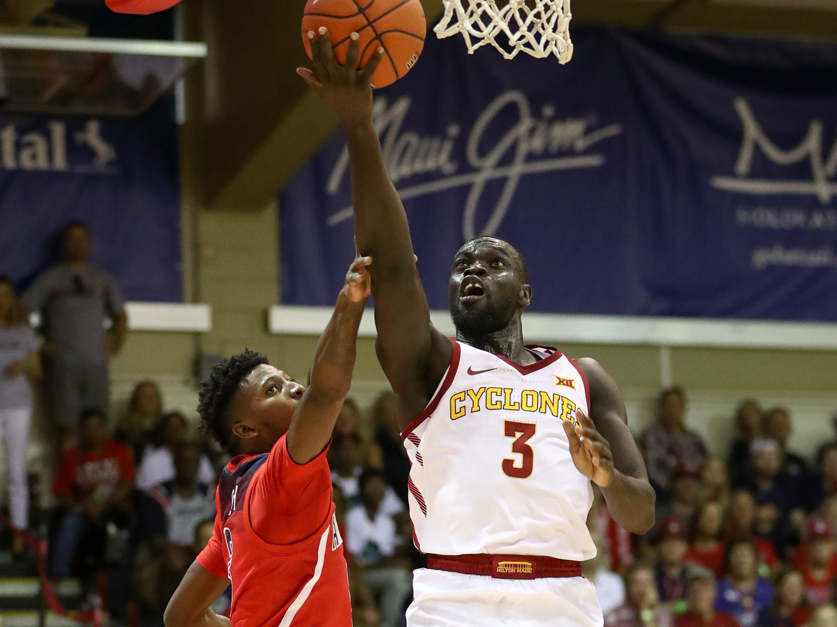 Marial Shayok #3 of the Iowa State Cyclones lays the ball in as he is guarded by Dylan Smith #3 of the Arizona Wildcats during the first half of the game at Lahaina Civic Center on November 19, 2018 in Lahaina, Hawaii.