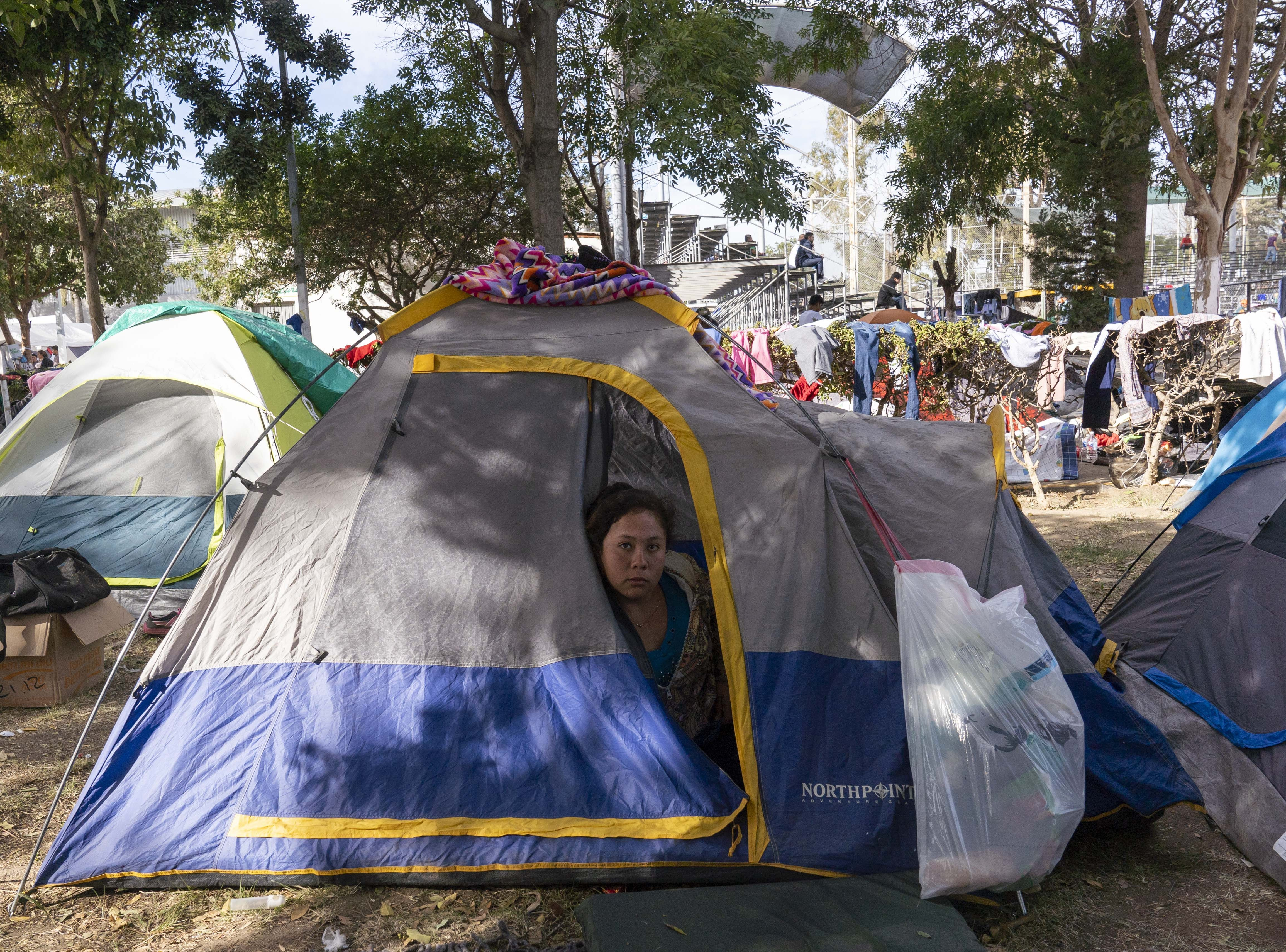 More than 2,500 mostly Central American migrants were staying at the Unidad Deportiva Benito Juarez, a makeshift shelter, in Tijuana, Mexico, on Nov. 19, 2018. Migrants set up camp around the baseball stadium, propping up tents using whatever materials they have available. Bathrooms and outdoor showers were installed in the outfield.
