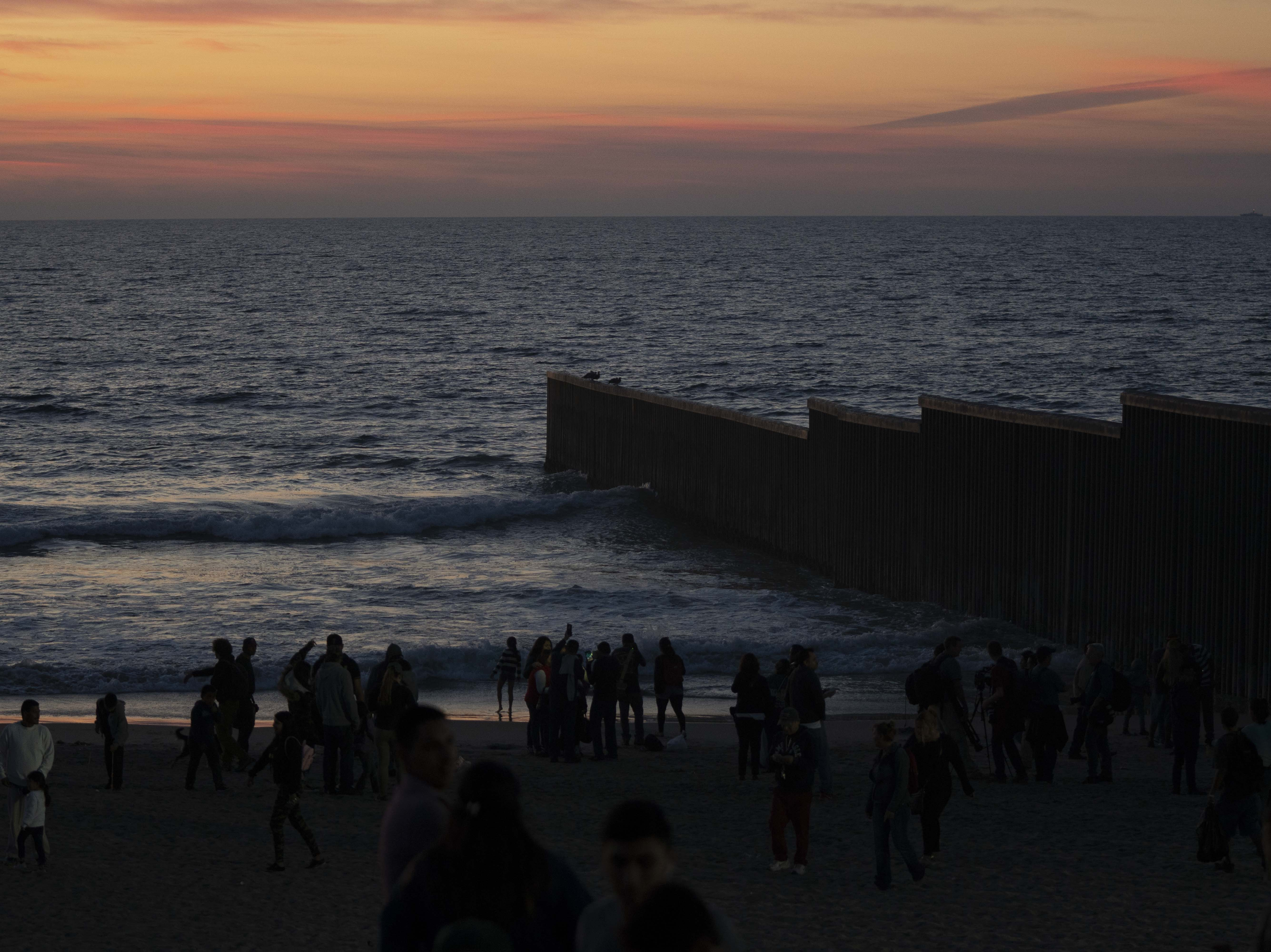 The barbed wire perched atop the US-Mexico border fence on Nov. 18, 2018, has become a viewing attraction for visitors to the popular Playas de Tijuana neighborhood south of San Diego.