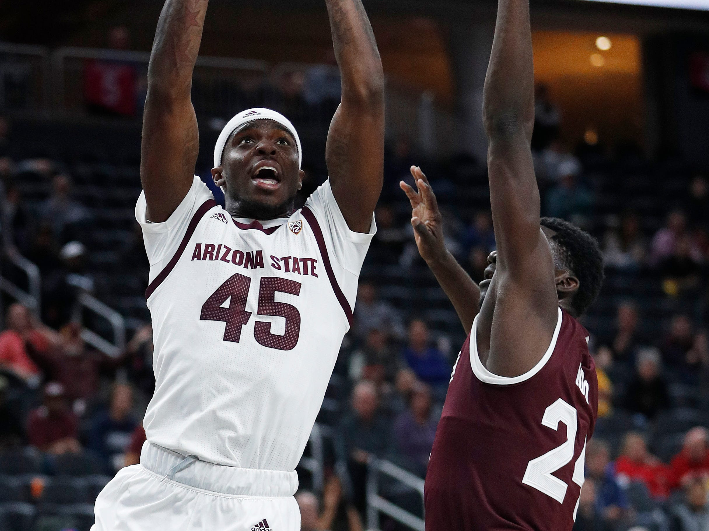 Arizona State's Zylan Cheatham (45) shoots around Mississippi State's Abdul Ado (24) during the first half of a NCAA college basketball game Monday, Nov. 19, 2018, in Las Vegas. (AP Photo/John Locher)