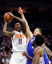 Suns guard Jamal Crawford looks to shoot over 76ers guard J.J. Redick during the first half of a game Monday.