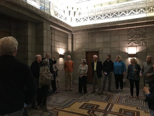 "Tour group stands in the ""Mystery Room"" which served at the hotel's speakeasy during Prohibition"