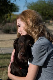 Laura Triem loves playing with her dog Floyd, who has been an instrumental part of her recovery from a horriffic accident in which she was hit by a light rail train while crossing the street in Denver.
