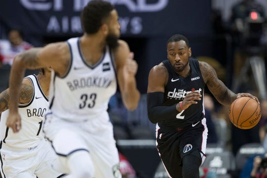 Wizards guard John Wall brings the ball up the court during a game against the Nets on Nov. 16.