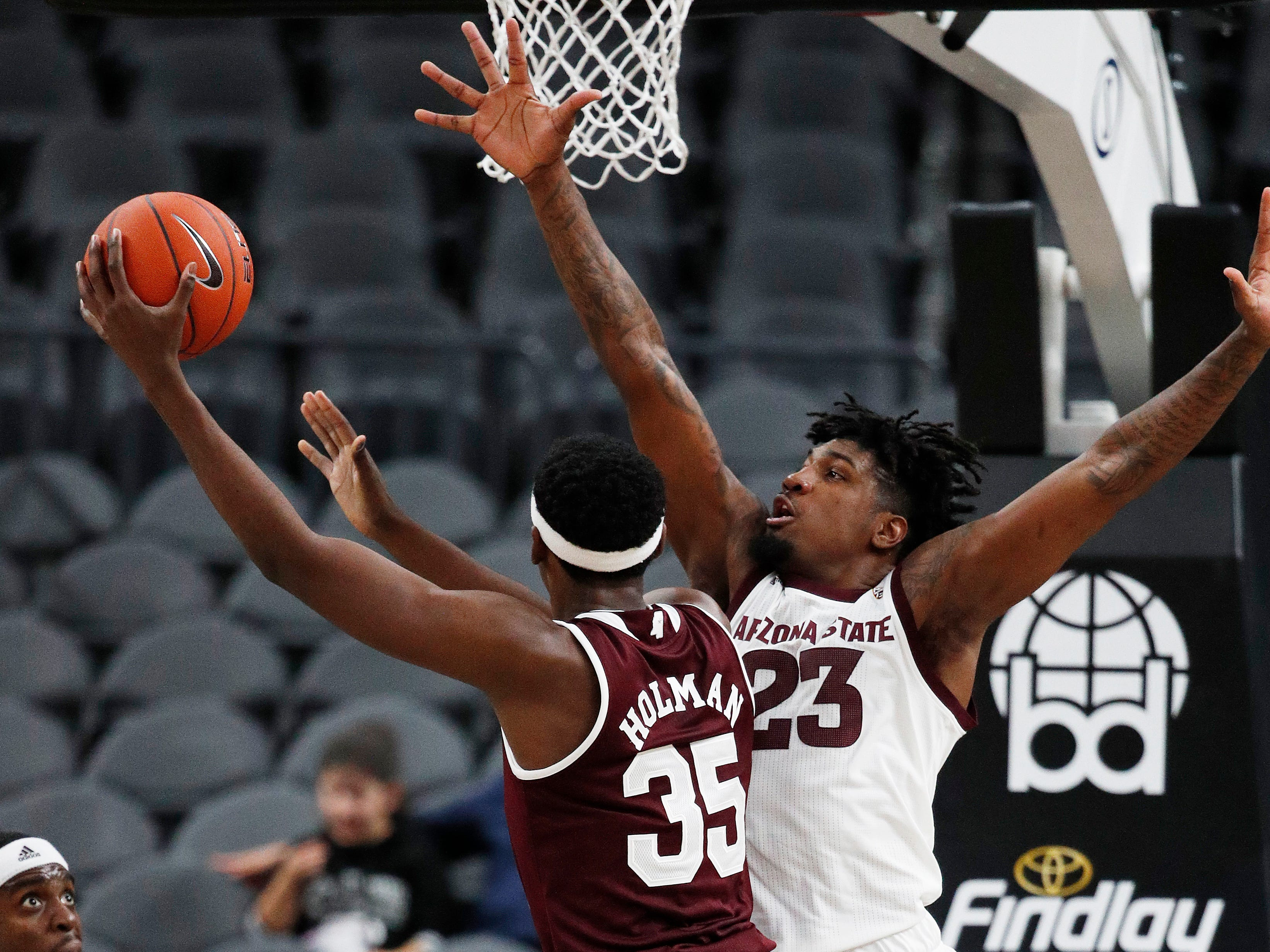 Mississippi State's Aric Holman (35) shoots around Arizona State's Romello White (23) during the first half of a NCAA college basketball game Monday, Nov. 19, 2018, in Las Vegas. (AP Photo/John Locher)