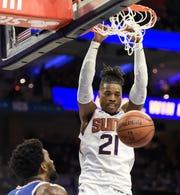 Phoenix Suns' Richaun Holmes (21) dunks the ball over Philadelphia 76ers' Joel Embiid (21) in the first half of an NBA basketball game, Monday, Nov. 19, 2018, in Philadelphia. (AP Photo/Michael Perez)