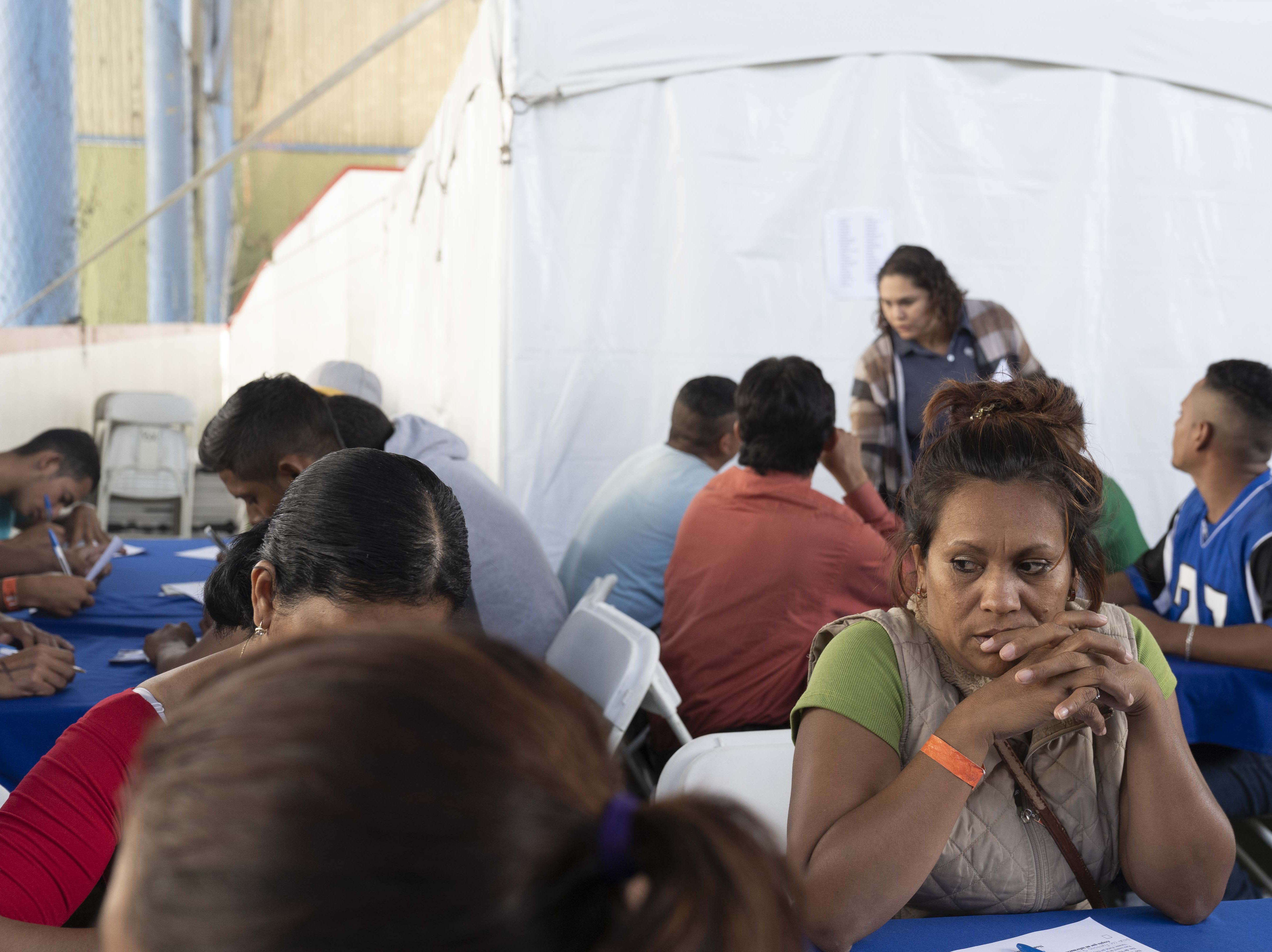 11/19/18 12:21:34 PM -- Tijuana, Mexico. Maritza Lara, a migrant from Honduras, jumped at the chance to find a job in Mexico in order to move out from the shelter. Government and business leaders kicked off on Monday a month-long job fair aimed at helping out stranded migrants that had traveled up here in a caravan, and possible getting them to stay in Mexico, rather than pursue asylum claims in the United States.  Photo by Nick Oza, Gannett