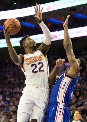 Phoenix Suns center Deandre Ayton (22) shoots as Philadelphia 76ers center Joel Embiid (21) defends during the first quarter at Wells Fargo Center.