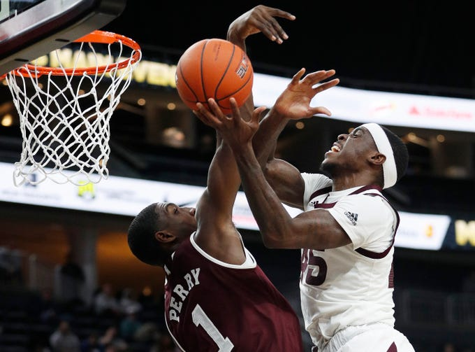 Arizona State's Zylan Cheatham (45) attempts a shot over Mississippi State's Reggie Perry (1) during the first half of a NCAA college basketball game, Monday, Nov. 19, 2018, in Las Vegas.