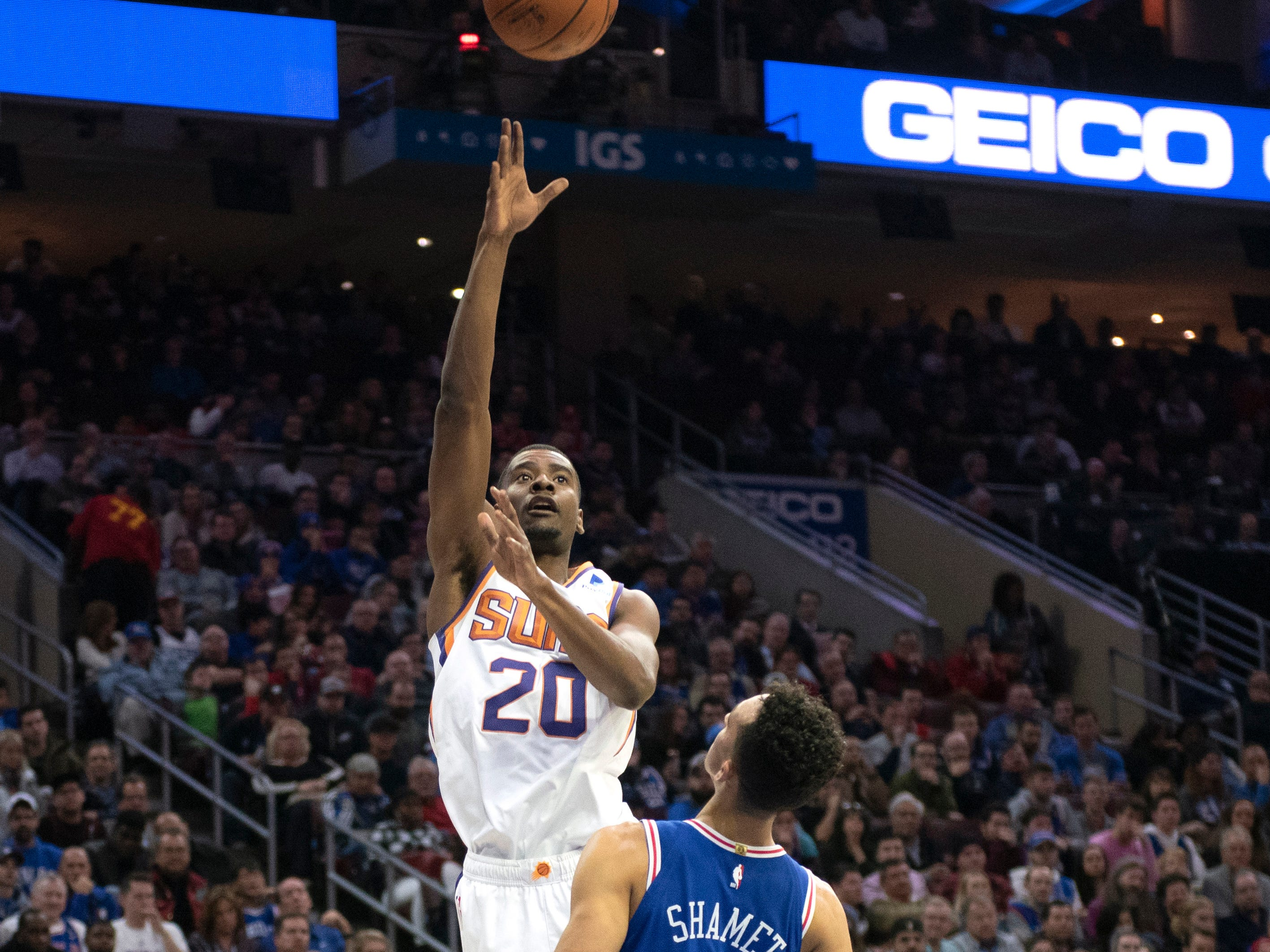 Phoenix Suns' Josh Jackson (20) takes a shot over Philadelphia 76ers' Landry Shamet (1) in the first half of an NBA basketball game, Monday, Nov. 19, 2018, in Philadelphia.