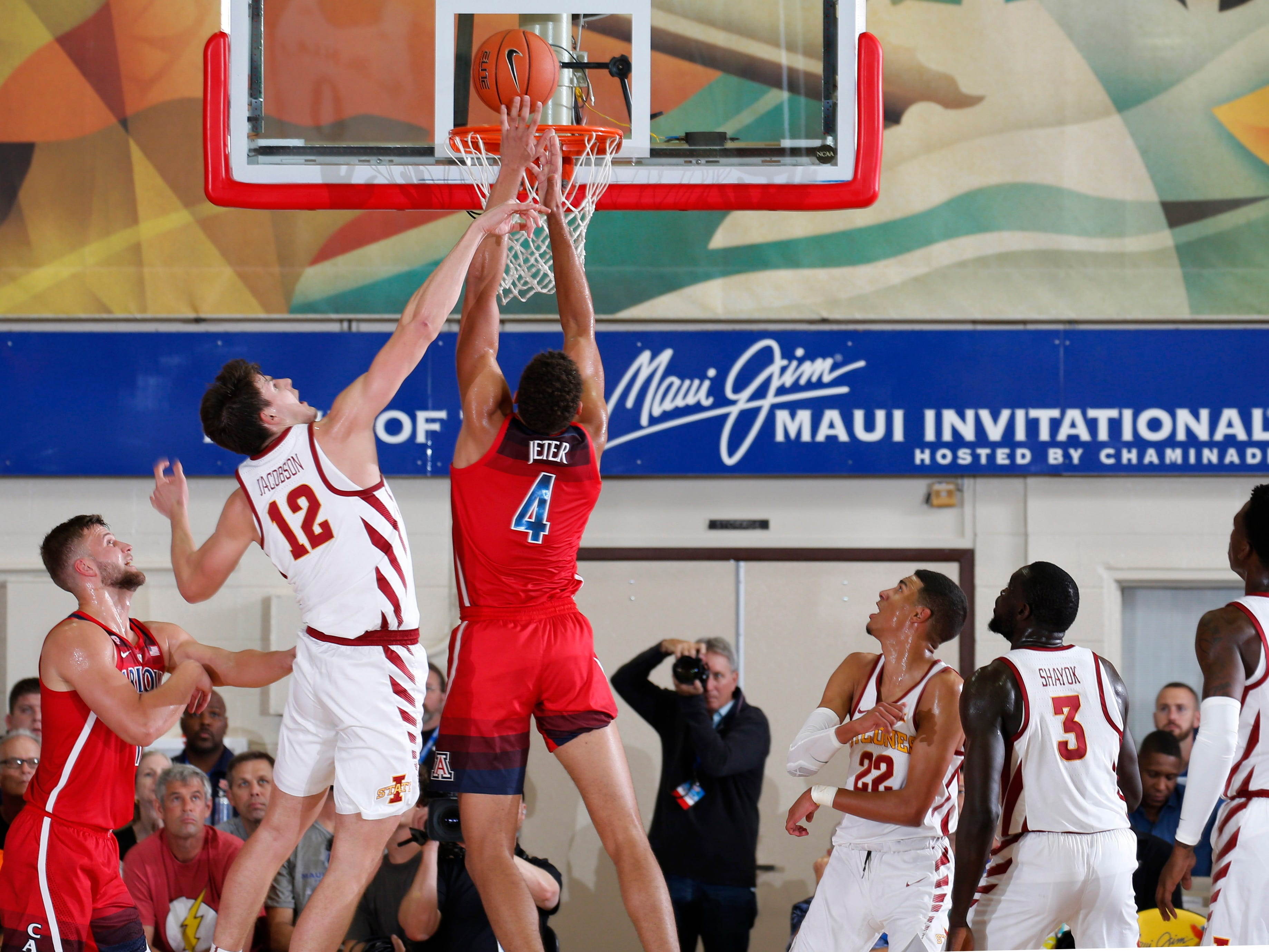Arizona Wildcats forward Chase Jeter (4) battles for a rebound against Iowa State Cyclones forward Michael Jacobson (12) in the second half during round one of the Maui Jim Maui Invitational at Lahaina Civic Center.
