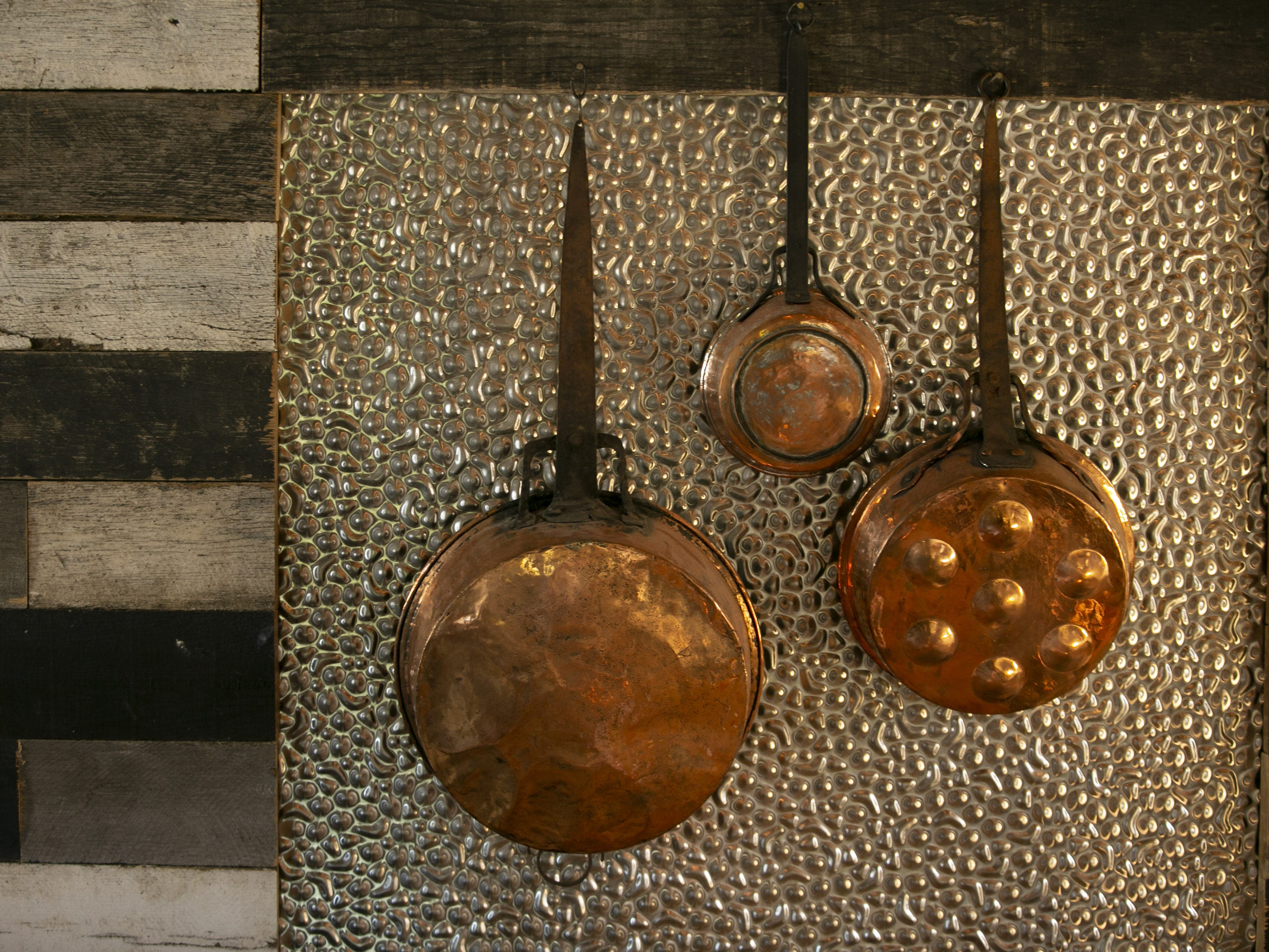 Copper pots hang on the wall at Bri restaurant in Phoenix on Nov. 12, 2018.